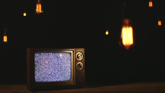 old television set under vintage light bulbs - old lightbulb stock videos and b-roll footage