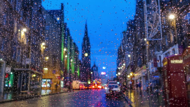 Old town Edinburgh and Edinburgh castle in Scotland UK rainy day