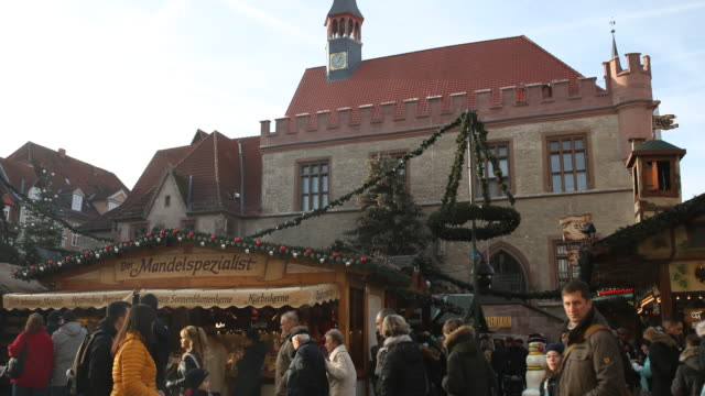 old town hall and christmas market with christmas decoration in germany visitors are enjoying arts and crafts and are tasting drinks like mulled wine... - advent calendar stock videos & royalty-free footage