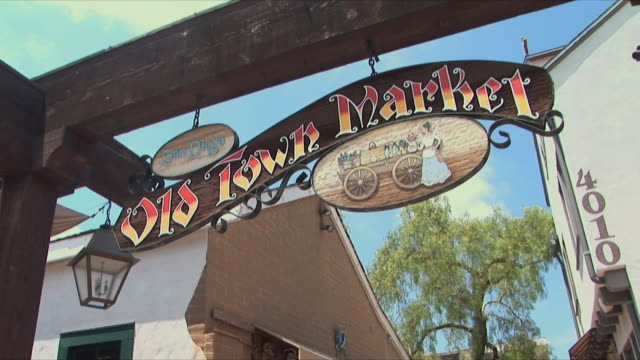 cu td ms old town market sign and people walking along stalls, san diego, california, usa - san diego stock videos & royalty-free footage