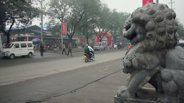 ws old town street with stone lion/hancheng,shaanxi,china - animal representation stock videos and b-roll footage