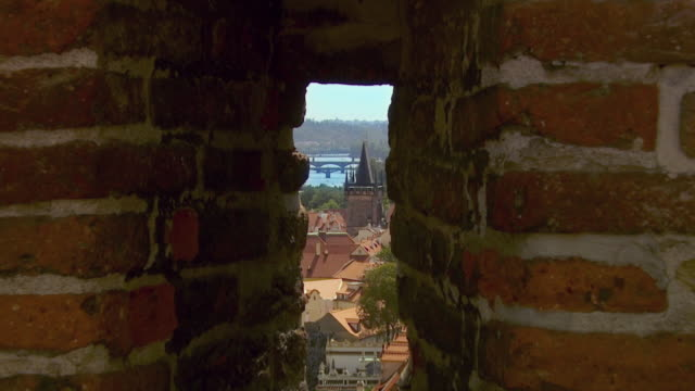 ws ha zi old town through fort window with vltava river bridges and church steeple / prague, czech republic - vltava river stock videos & royalty-free footage