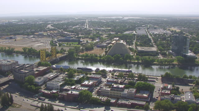 ws aerial pov old town with tower bridge and delta king moored in sacramento river, california - old town bridge tower stock videos and b-roll footage