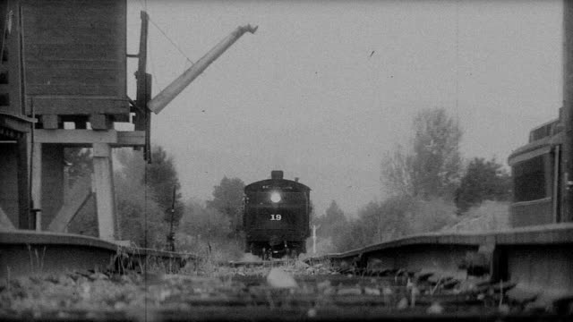 stockvideo's en b-roll-footage met old train pulling into station - locomotief