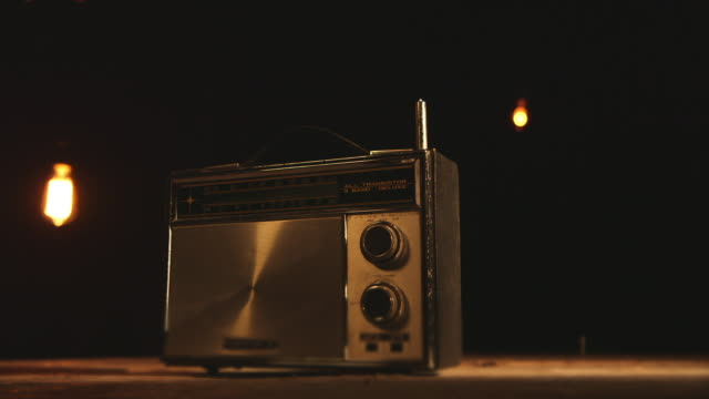 old transistor 3-band radio under vintage light bulbs - radio stock videos & royalty-free footage