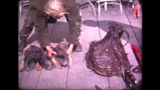 vídeos de stock, filmes e b-roll de 1963 old trapper proudly exhibits animal pelts - pelo animal