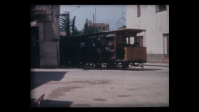 1963 old trolley car on city street - trolleybus stock-videos und b-roll-filmmaterial