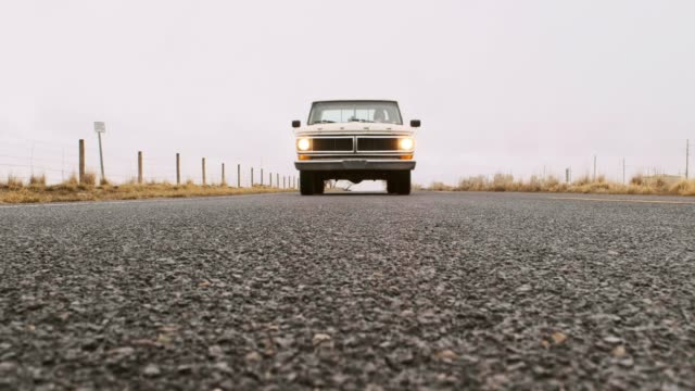 old truck on an empty road - inquadratura dal basso video stock e b–roll