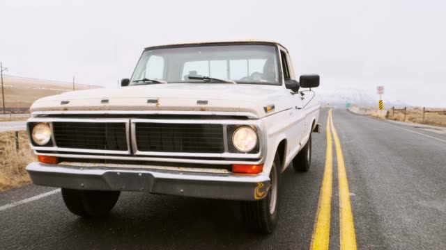 old truck on an empty road - customs stock videos & royalty-free footage