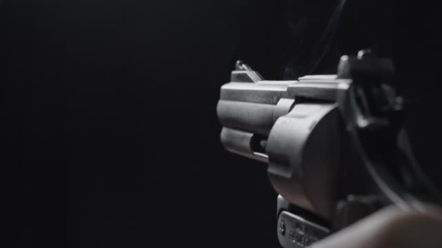old type gun on black background - shooting a weapon stock videos & royalty-free footage