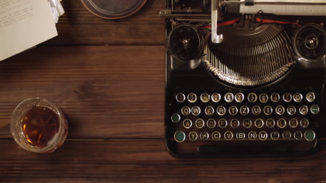 ds old typewriter on a neat vintage office desk - typewriter stock videos & royalty-free footage
