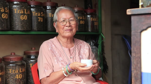 MS Old Vietnamese woman in Shop of tea leaf / Quan Binh Thanh, Ho Chi Minh, Vietnam