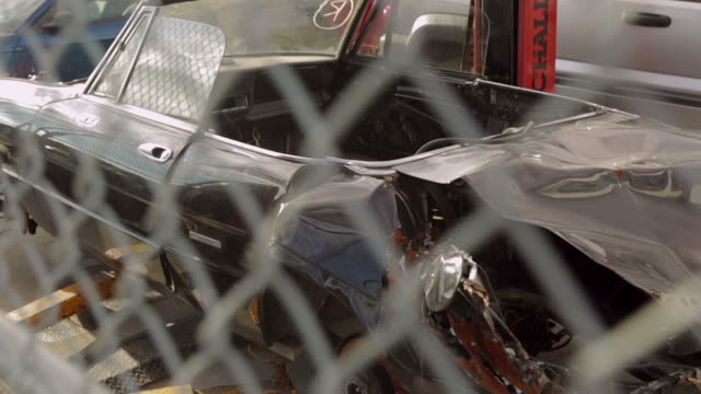 old vintage car with fence in foreground slow motion - retro convertible stock videos & royalty-free footage