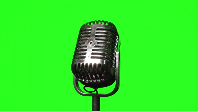 old vintage microphone on green screen background - single object stock videos & royalty-free footage