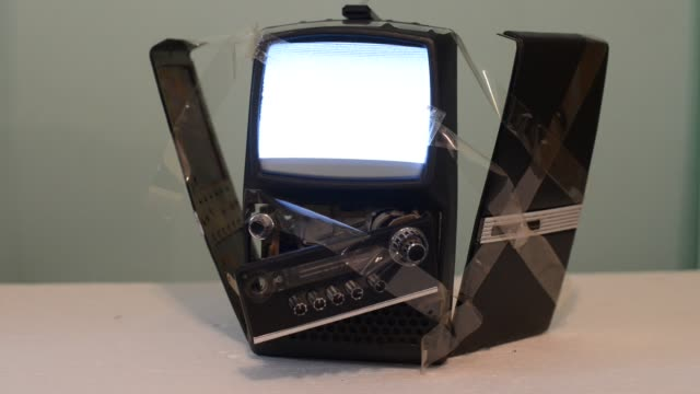 old vintage mini tv fixed with duct tape and still working - electrical equipment stock videos & royalty-free footage