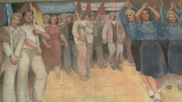 cu old wall paintings of german democratic republic at german ministry of finance and leipziger strasse street / berlin, germany - female likeness stock videos & royalty-free footage