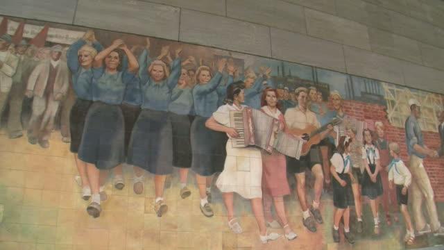 cu pan old wall paintings of german democratic republic at german ministry of finance and leipziger strasse street / berlin, germany - east germany stock videos & royalty-free footage
