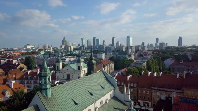 old warsaw in the afternoon sun with skyscrapers of the new city in the background. - varsavia video stock e b–roll