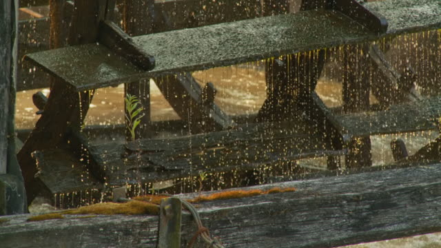 hd slow motion: old water wheel - watermill stock videos and b-roll footage