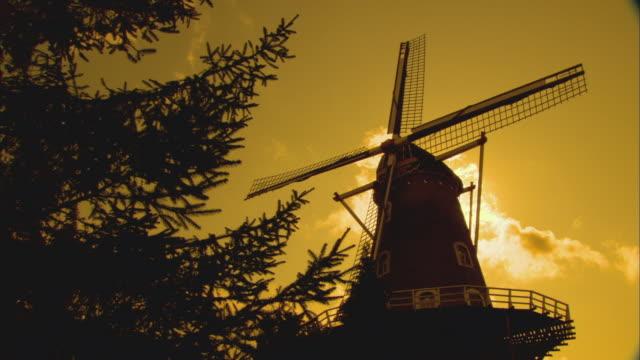 T/L WS LA Old windmill against sky, yellow filter / Maasbommel, Holland