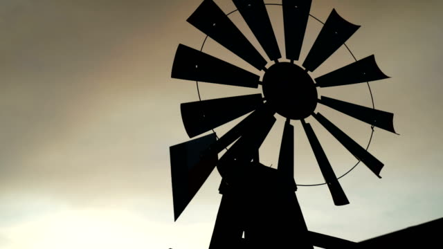 old windmill silhouette - water pump stock videos & royalty-free footage