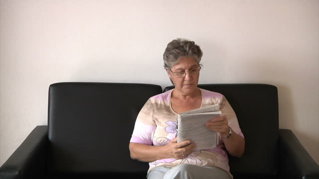 old woman and newspaper - old newspaper stock videos and b-roll footage
