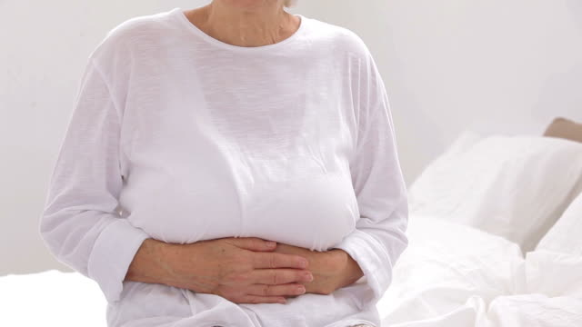 Old woman complaining of stomach pain