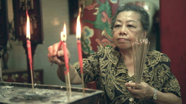 old woman hand lighting incense sticks - tradition stock videos & royalty-free footage