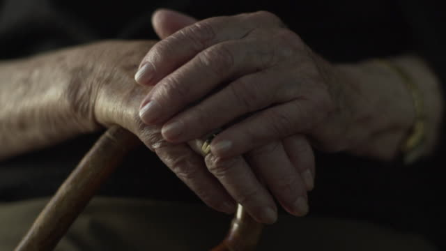 C/U old woman hands w/ cane