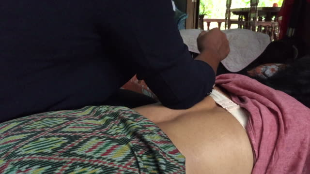 old woman having relaxing with thai massage - anti aging stock videos and b-roll footage