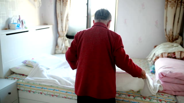 Old woman in the bedroom