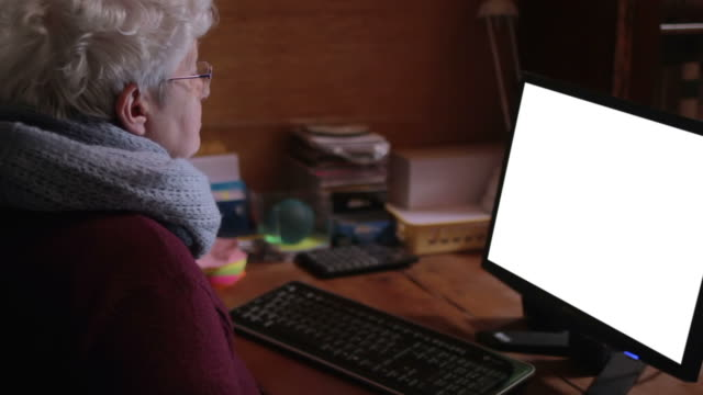 old woman looking at computer screen - old computer monitor stock videos & royalty-free footage