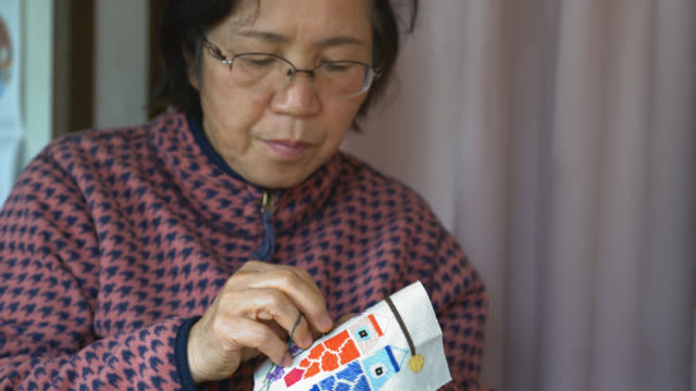 old woman making a traditional embroidery - embroidery stock videos & royalty-free footage