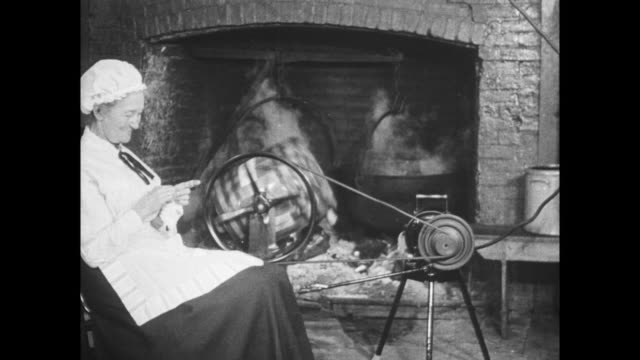 old woman rocking in rocking chair and knitting while electric butter churn works by fireside - electric chair stock videos & royalty-free footage