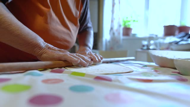 old woman rolling cookie dough - rolling pin stock videos & royalty-free footage