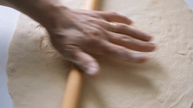 old woman rolling dough with rolling pin on kitchen counter - rolling pin stock videos & royalty-free footage