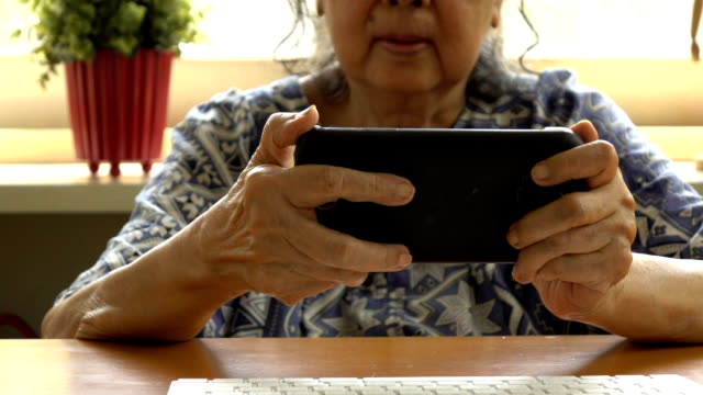 Old woman with smartphone. Senior people using internet