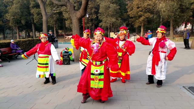 old women dance in jingshan hill china - traditional clothing stock videos & royalty-free footage