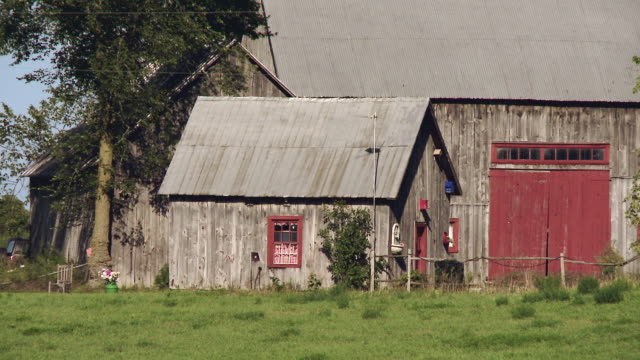 old wooden barn with a wooden house beside - barn stock videos & royalty-free footage