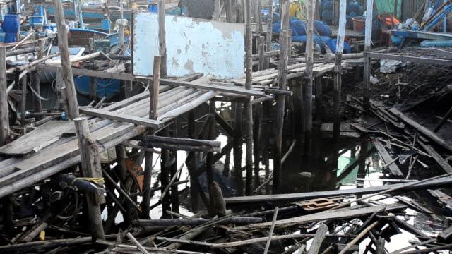 old wooden bridge in fishing pier community. - log stock videos & royalty-free footage