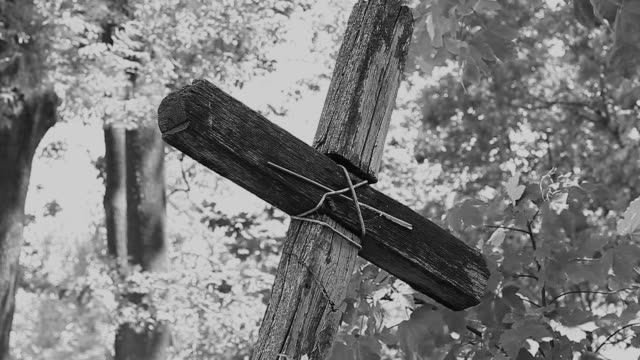 old wooden cross on the background of trees - wood material stock videos & royalty-free footage
