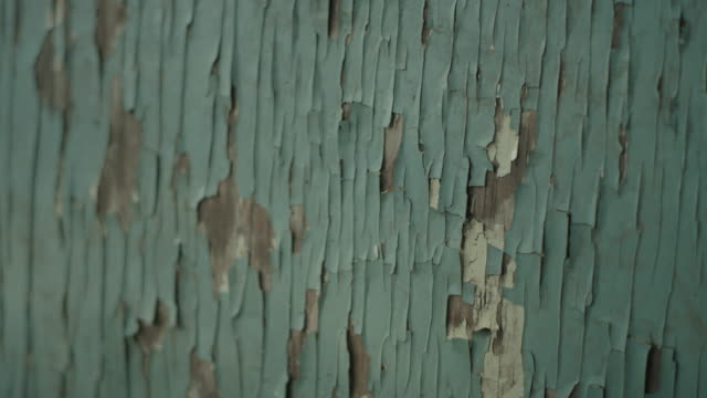 Old wooden surface. Cracked paint