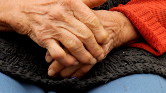 Old wrinkled farmers hands