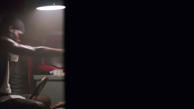 vidéos et rushes de slo mo. older boxing coach trains a young man how to box by punching his hands in the locker room in a professional gym - fist