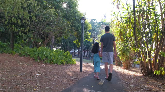 older brother walking with girl in park with trail - pardo brazilian stock videos & royalty-free footage