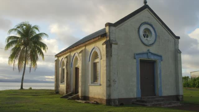 Older building on coastline overlooking ocean