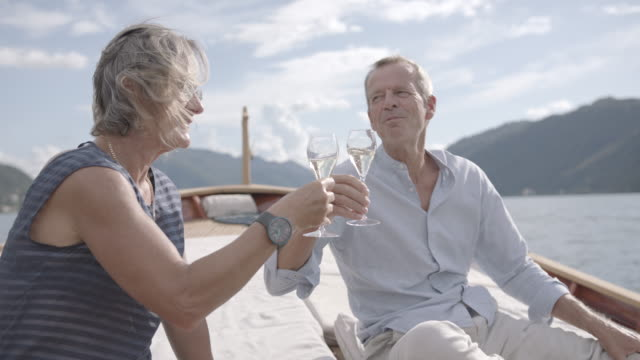 older couple enjoying champagne on a boat on a lake - 60 69 years stock videos & royalty-free footage