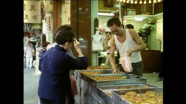 older female shoppers buy mooncakes in hong kong - paper bag stock videos & royalty-free footage