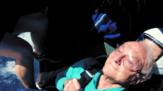 older gentleman goes tandem skydiving - skydiving stock videos & royalty-free footage