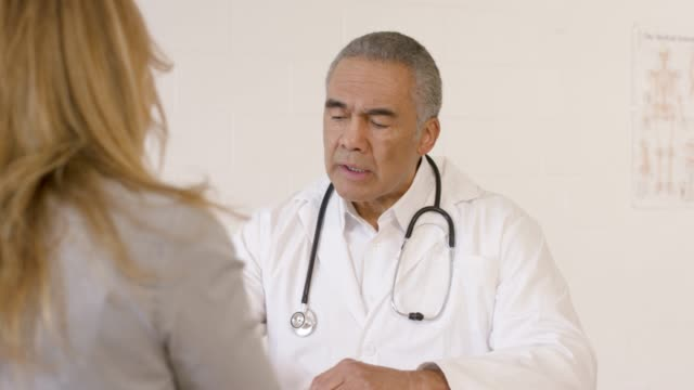 older male doctor talking to female patient - anti depressant stock videos & royalty-free footage